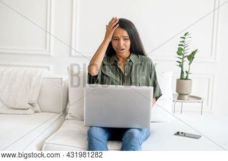 Upset And Frustrated Young Indian Woman Using Laptop For Remote Work From Home, Nervous About Mistak