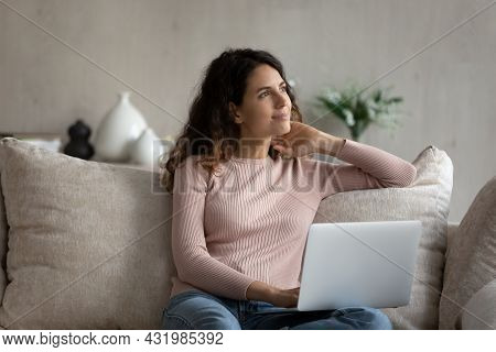Dreamy Happy Young Woman Using Computer At Home.