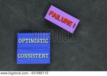 Colored Boards With The Words Optimistic, Consistent And Failure. Success Concept