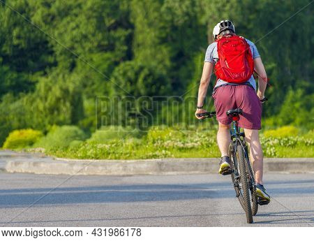 Cyclist Pedaling On A Racing Bike Outdoors  .the Image Of Cyclist In Motion On The Background In The
