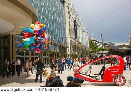 Frankfurt, Germany - June 15, 2016: The Dealer Of Colorful Balloons Walking Along The Zeil In Midday