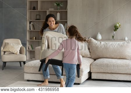 Happy Two Gen Female Family Homeowners Decorating House Together.