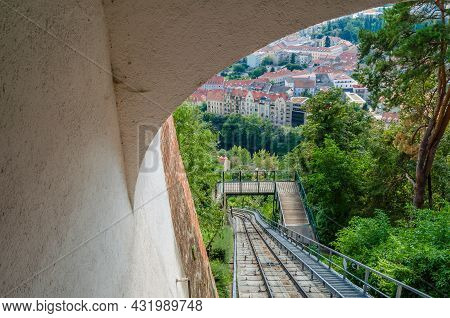 View Of The City Of Graz, Austria, With The Rails Of Rhe Schlossbergbahn  Funicular Railway In The F