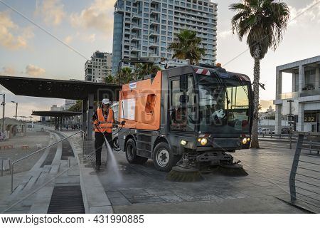 Tel Aviv, Israel - August 17th, 2021: A Street Sweeper At Work, Early Morning, On The Lahat Promenad