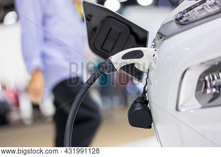 Electric Car Charging Station. Hybrid Car Electric Charger Station In The Car Park. Electric Car Cha