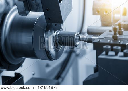 The  Cnc Lathe Machine Bore Cutting The Metal Shaft Parts. The Hi-technology Metal Working Processin
