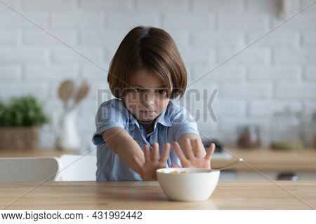 Stubborn Little Kid Boy Rejecting Eating Dry Breakfast.