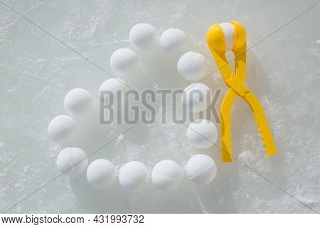 A Lot Of Snowballs Laid Out On The Ice In The Form Of A Heart. A Tool For Modeling Snowballs. Frozen