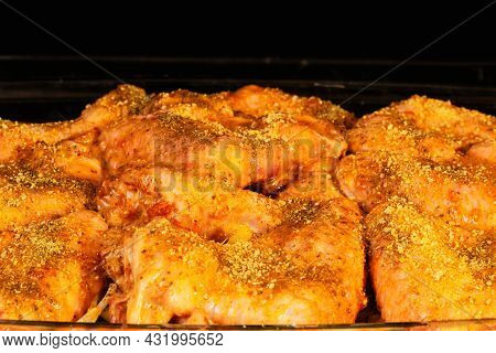 Raw Marinated Chicken Legs Are Cooked In The Oven. Chicken In Spicy Spices Close-up