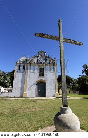 Porto Seguro, Bahia, Brazil - July 18, 2021: Cross And Church Of Our Lady Of Pena In The Historic Ce