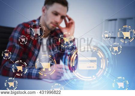 Businessman Wearing Red Shirt Is Taking Notes In Front Of Laptop With Interface With Icons Of Credit