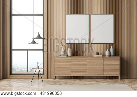 Two Posters In The Modern Wooden Living Room With Wall Panelling, A Sideboard, Pendant Lamps, A Coff