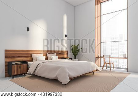 White Bedroom Interior With A Desk In A Window Niche And Wood Bed With Bedside Tables And Modern Pen