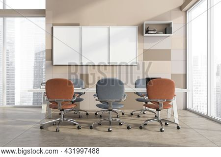 Three Office Canvases On The Beige Tile Wall With A Ledge Shelf And A Conference Table With Creative