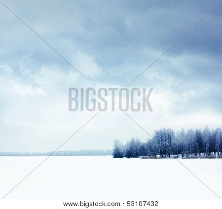 Winter Landscape with Snowy Field and Moody Sky