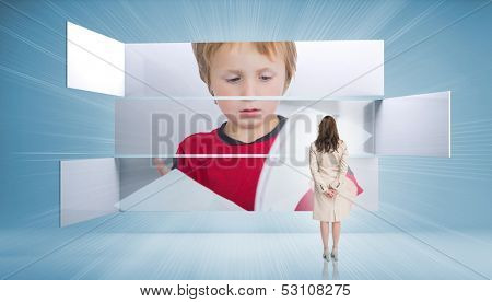 Rear view of businesswoman looking at pupil on blue background poster