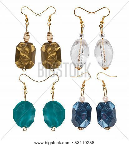 Earrings Made Of Plastic And Glass On A White Background. Four Pairs