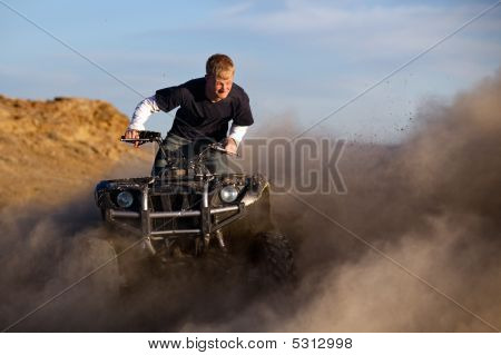 Quad Atv Kicking Up Dust
