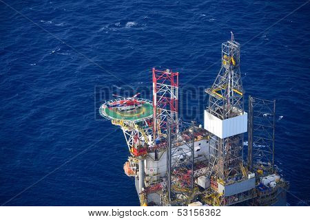 Helicopter Embark Passenger On The Offshore Oil Rig.