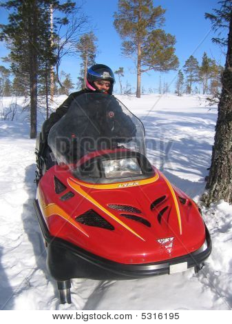 Man Driving Snowmobile