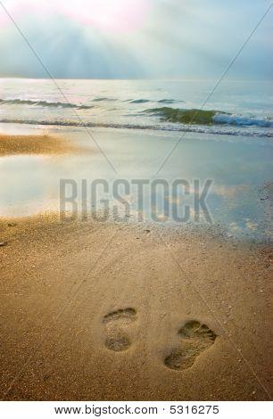 Footprints On The Beach At Dusk