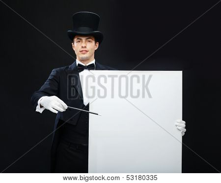 performance, circus, show, advertisement concept - magician in top hat with magic wand and white board showing trick
