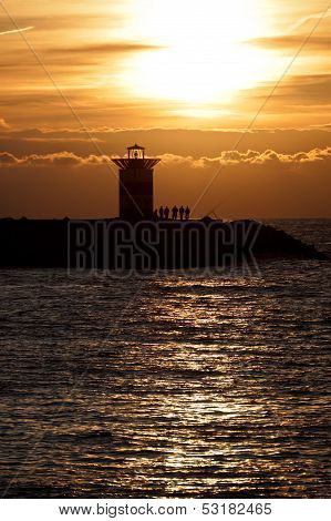 Sunset at a dutch lighthouse in Scheveningen