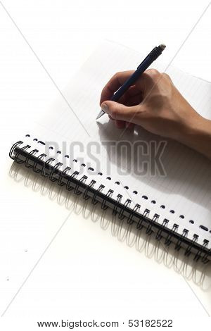 Writing note on piece of paper