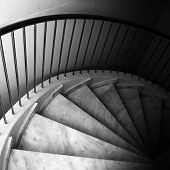 Marble footsteps on spiral ladder. Monochrome photo poster