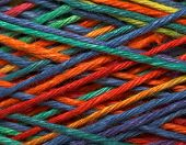 The multicolored yarn used for knitting clothes poster