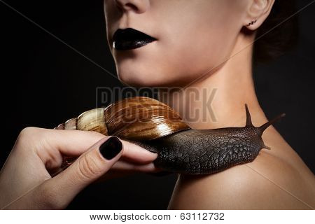 Woman With Snail. Fashion. Gothic