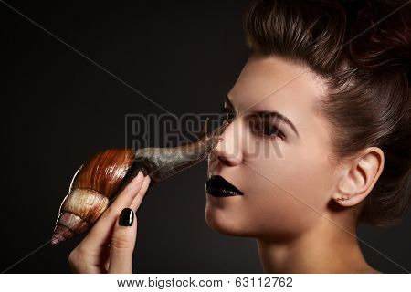 Woman With Snail On The Nose. Fashion. Gothic