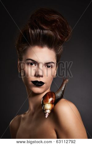 Portrait Of A Woman With Snail With Black Eyes And Lips. Fashion. Gothic