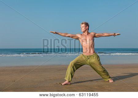 Man Meditating In Warrior Pose