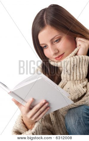 Portrait Of Young Happy Woman With Book Wearing Turtleneck