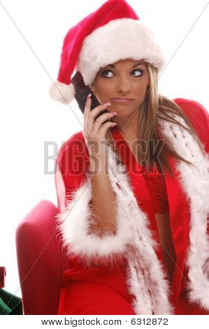 A very sexy Mrs. Santa Claus talking to the Elves on her brand new cellphone poster