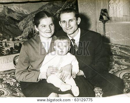 SZCZECINEK, POLAND, CIRCA 1950's: Vintage photo of parents with a baby