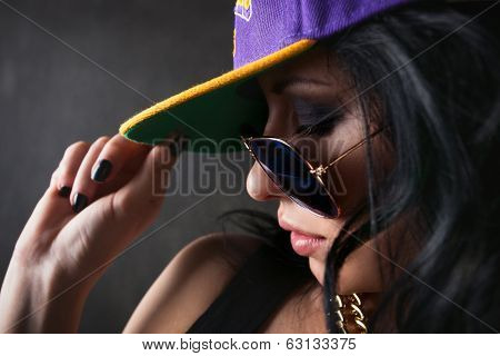 Attractive Brunette In A Cap Covering Her Eyes