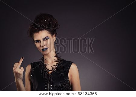 Sexy Creative Woman Shows Gesture And Smiling. Rocker Style.