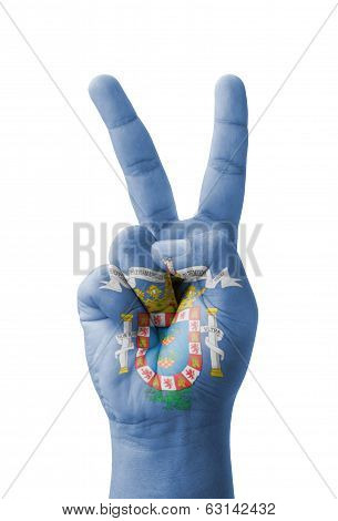 Hand making the V sign Melilla flag painted as symbol of victory win success - isolated on white background poster