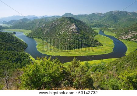 Crnojevica River flowing curved into Skadar Lake National Park, Montenegro poster