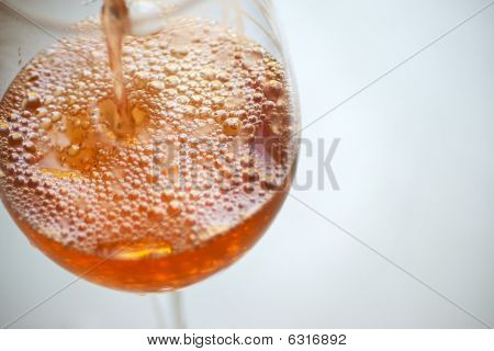 Rosa Being Poured Into A Wine Glass
