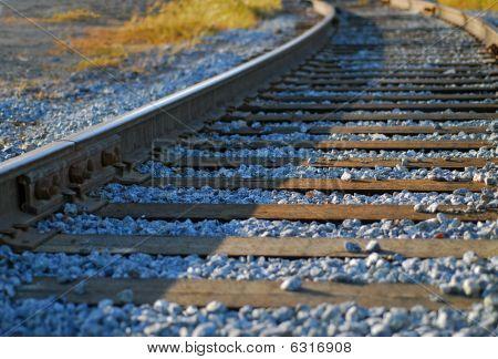 Rail Track Curve At Dusk