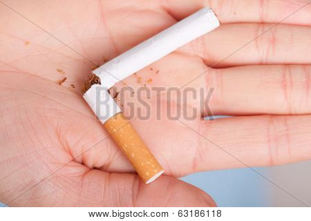 Addiction. Broken Cigarette On Hand. Quit Smoking