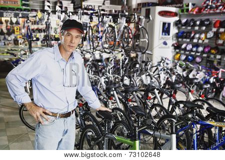 Portrait of man standing in bike shop
