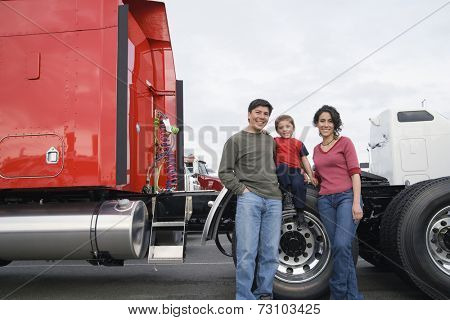 Family standing by their truck