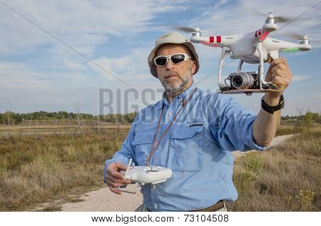 FORT COLLINS, CO, SEPTEMBER 28, 2014:  Photogrpaher, Marek Uliasz, is launching the DJI Phantom 2 quadcopter drone with Panasonic Lumix GM1 camera on board.