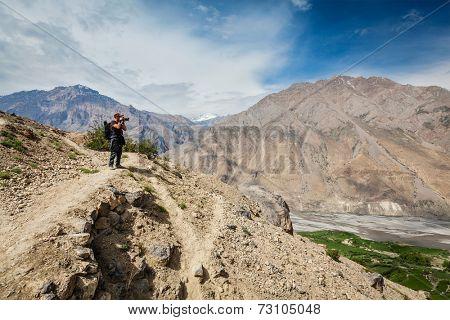 Photographer taking photos in Himalayas mountains. Spiti valley, Himachal Pradesh, India