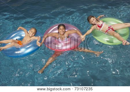Young girls floating in inner tubes
