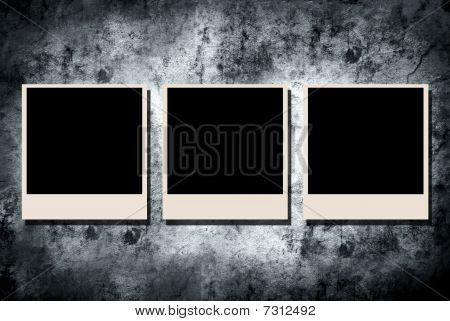 Photo frame on grunge wall